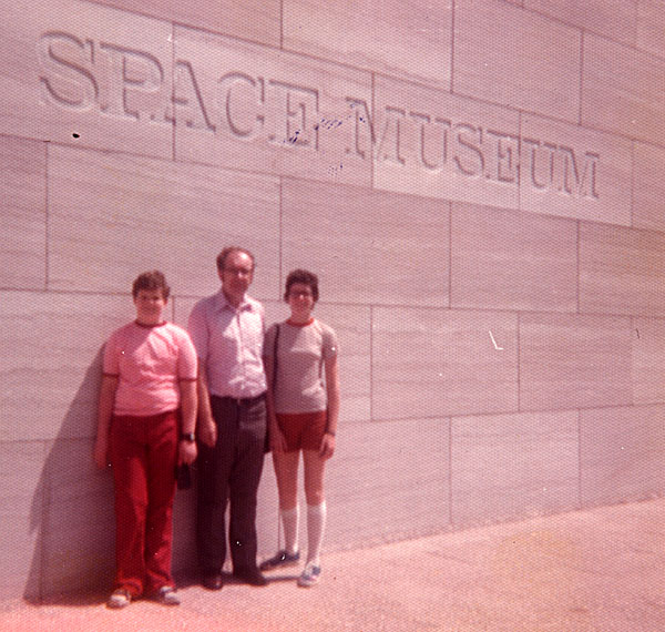 Two children and father in front of the National Air and Space Museum, 1976