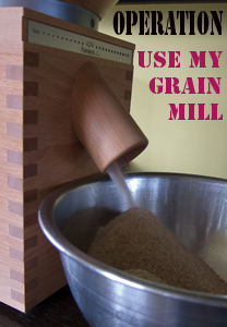 photo of grain mill, with flour pouring out, and the words Operation Use My Grain Mill